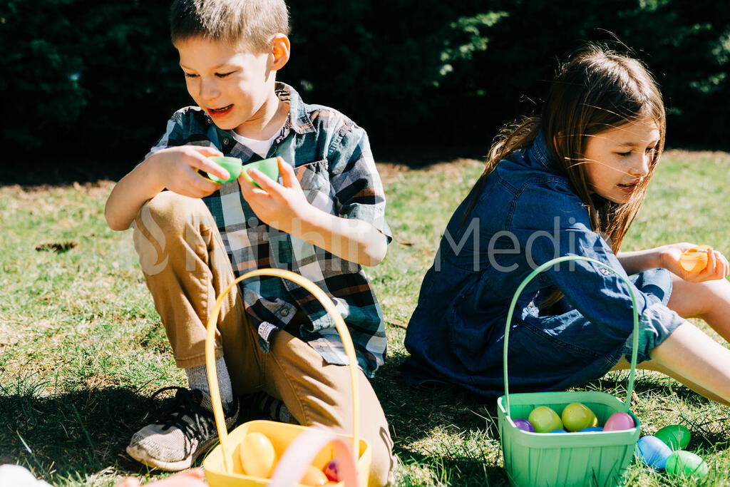 Kids Opening Their Easter Eggs Together large preview