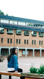 Student Sitting in an Empty College Campus  image 1