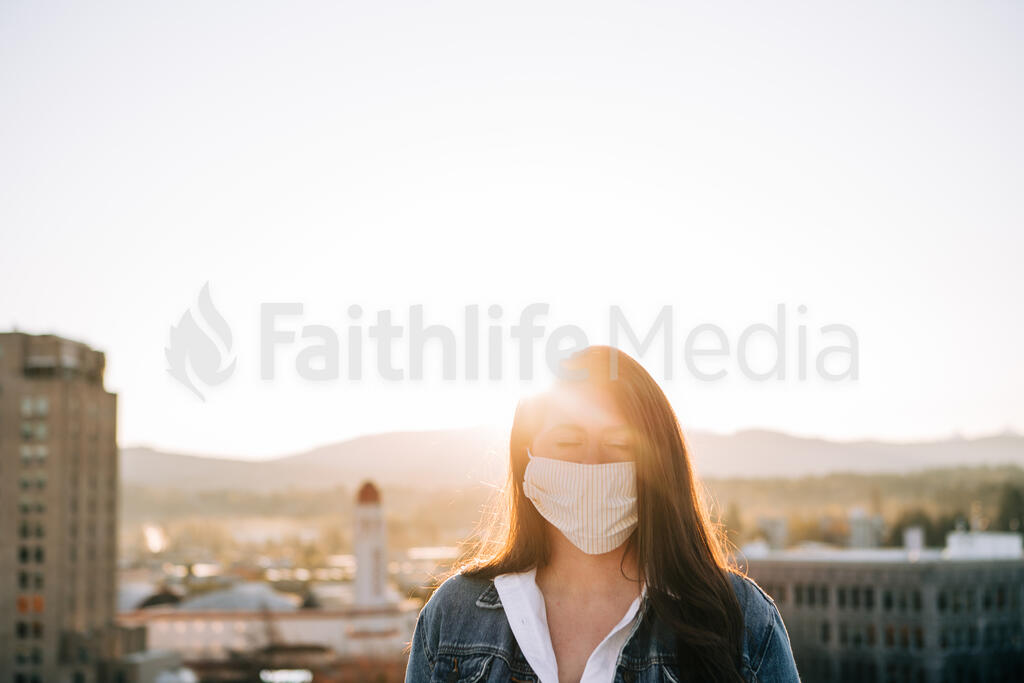 Woman Wearing a Face Mask at Sunrise large preview