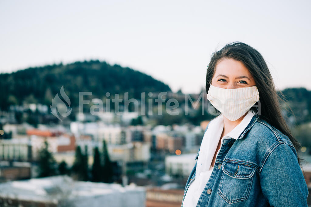 Woman Wearing a Face Mask and Smiling large preview