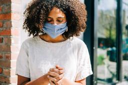 Woman Wearing a Mask and Praying  image 2