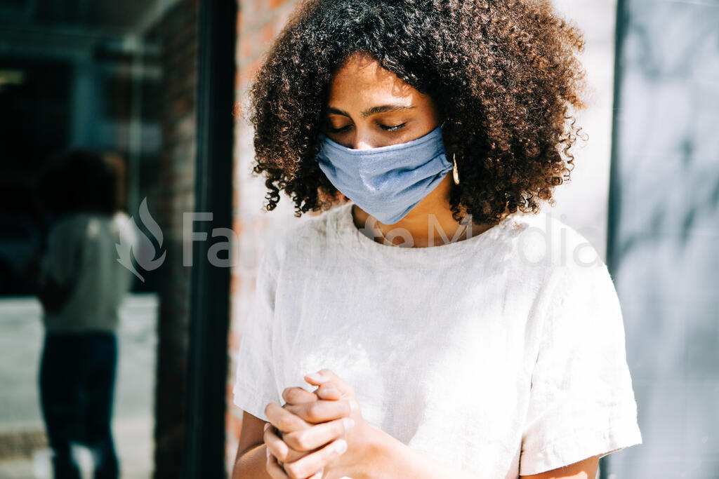 Woman Wearing a Mask and Praying large preview