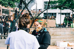 Volunteer Nurse Speaking with a Peaceful Protester  image 1