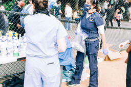 Volunteer Nurse Speaking with a Peaceful Protester  image 2