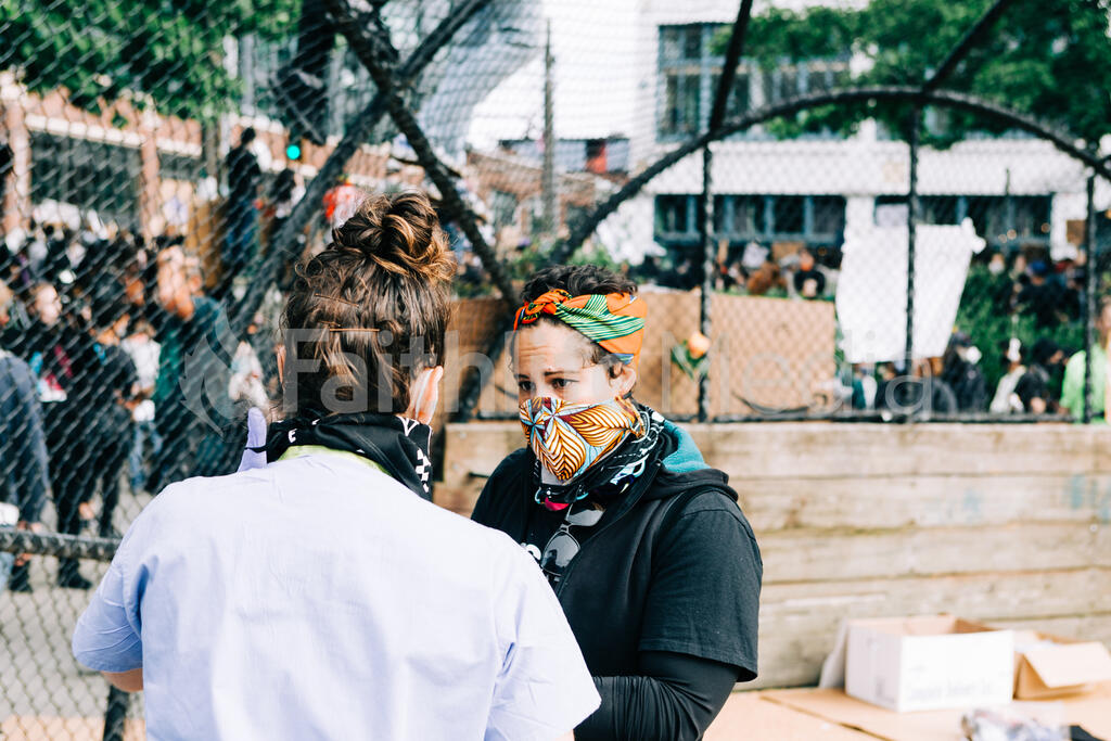 Volunteer Nurse Speaking with a Peaceful Protester large preview