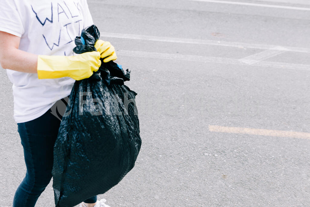 Volunteer Picking Up Trash After a Peaceful Protest large preview