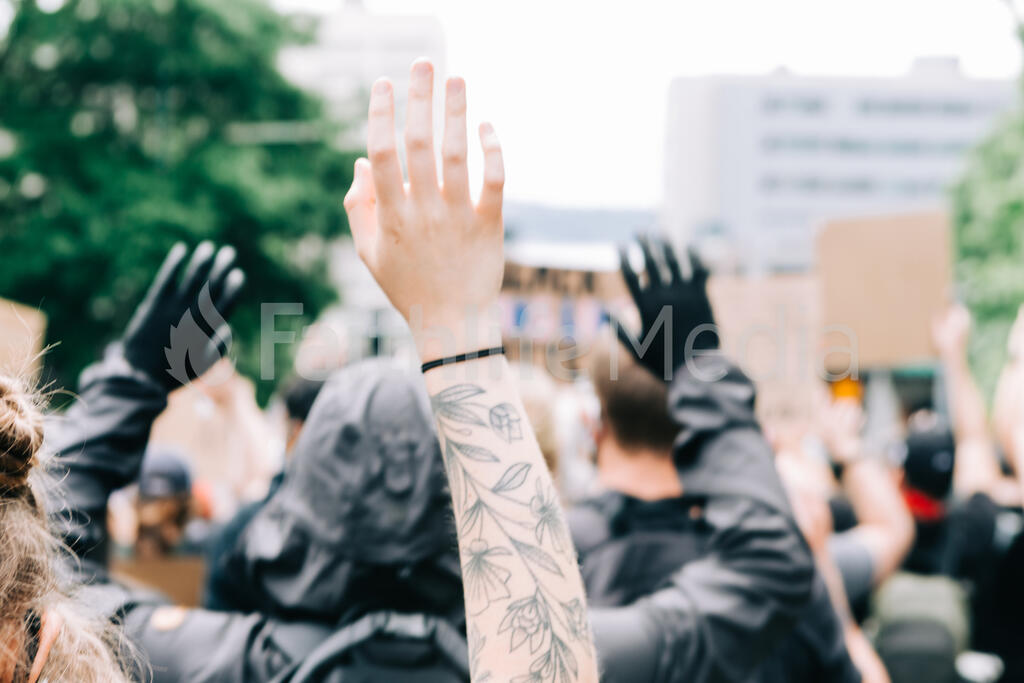 Peaceful Protesters with Their Hands Up large preview