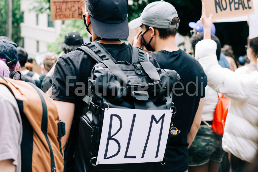 Peaceful Protester with a BLM Backpack large preview