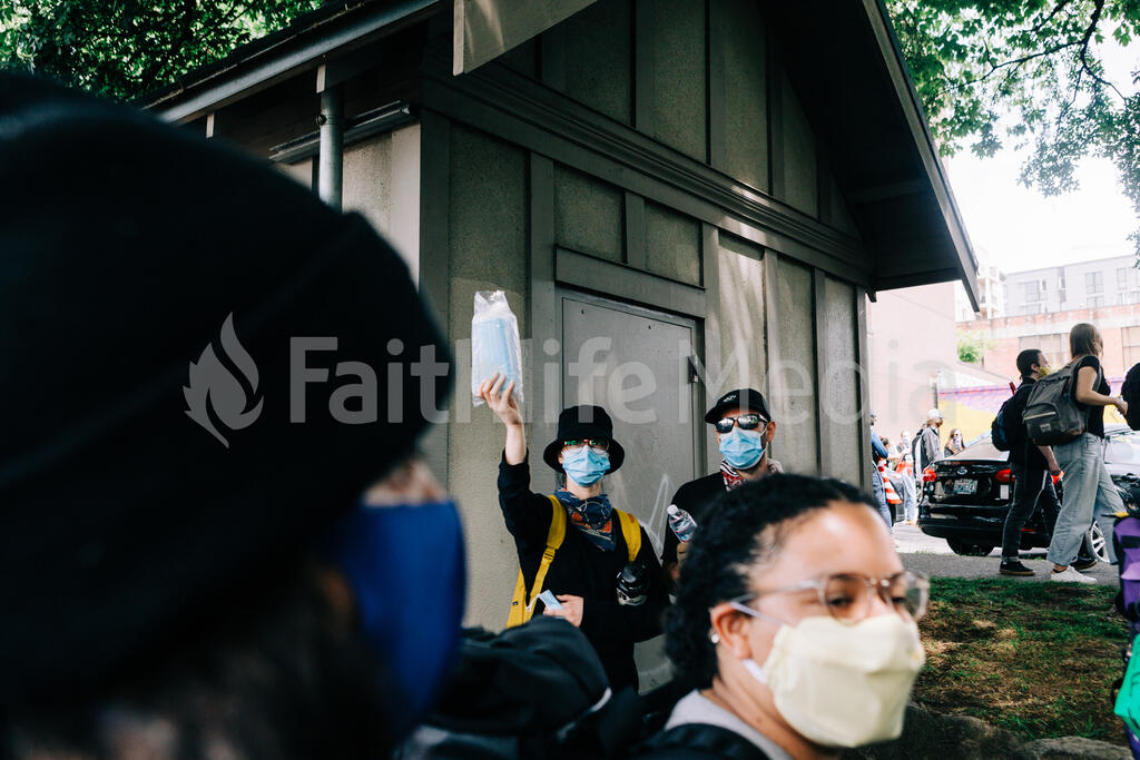 Peaceful Protesters Handing Out Face Masks large preview