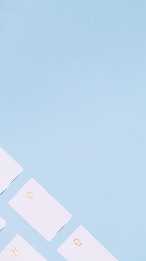 White Credit Cards on a Blue Background large preview