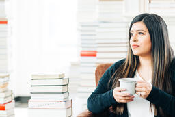Woman Drinking Coffee Surrounded by Books  image 3
