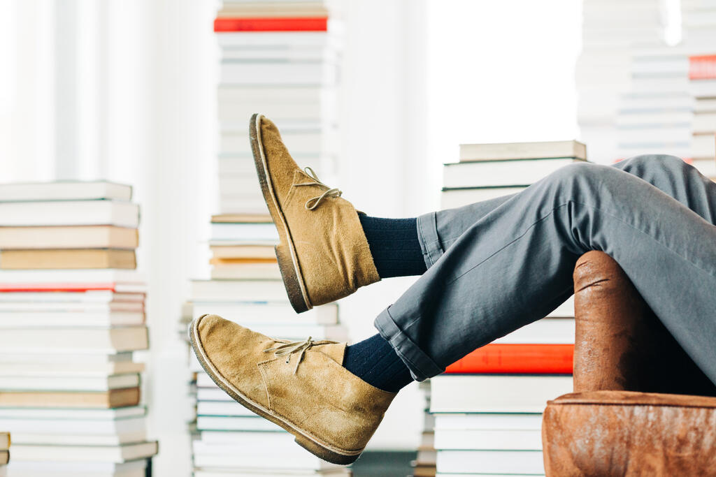 Man Sitting in a Living Room Full of Books large preview