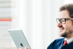 Man Studying on an iPad  image 4
