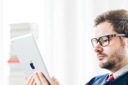Man Studying on an iPad  image 5