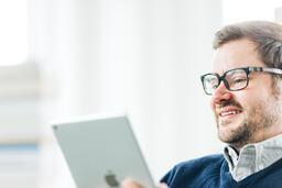 Man Studying on an iPad  image 3