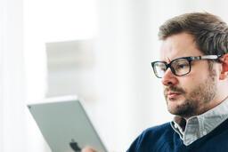 Man Studying on an iPad  image 1