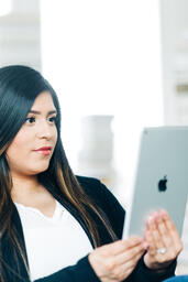 Woman Studying on an iPad  image 1