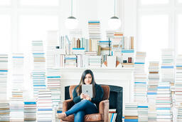 Woman Studying on an iPad in a Living Room Full of Books  image 4