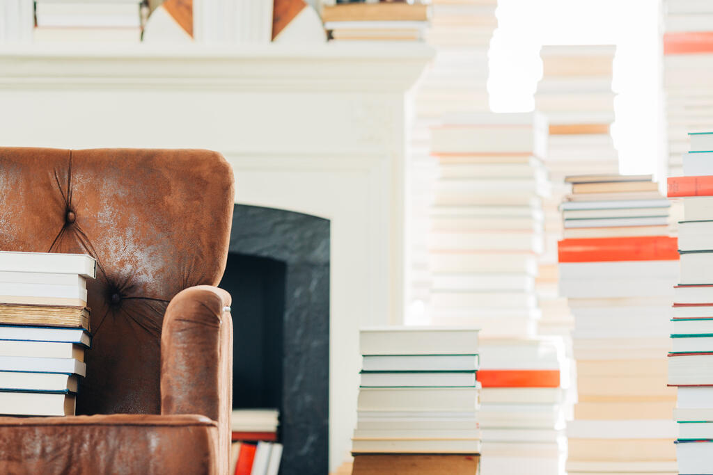 A Stack of Books on a Chair Surrounded by Books large preview