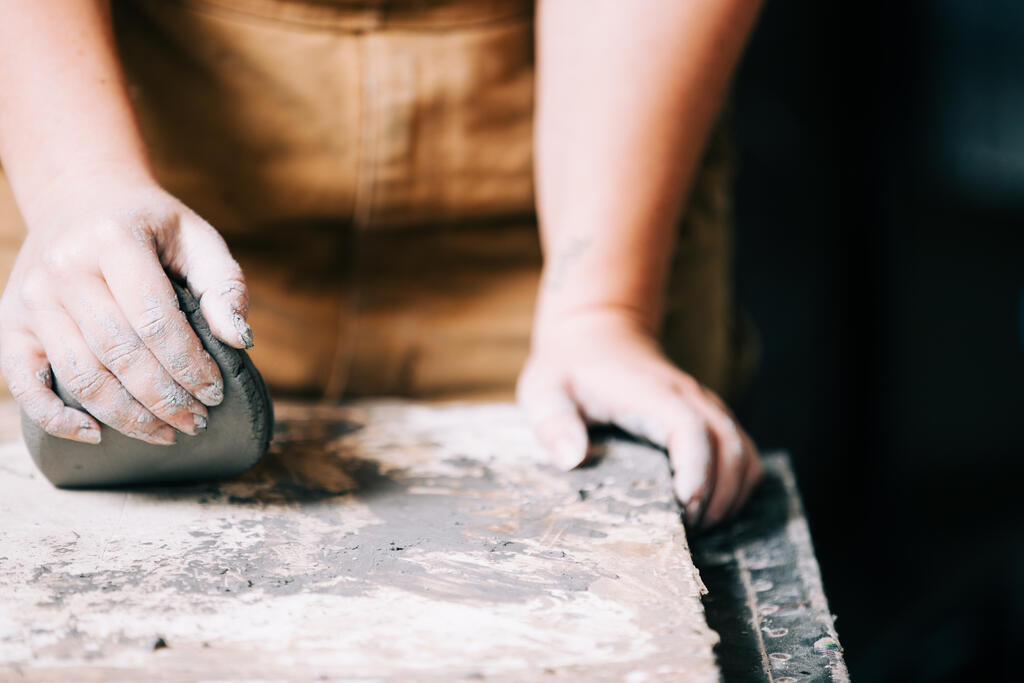 Hands Kneading Clay large preview
