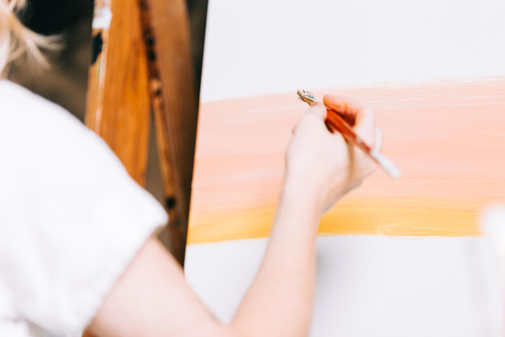 A Woman Painting a Canvas large preview