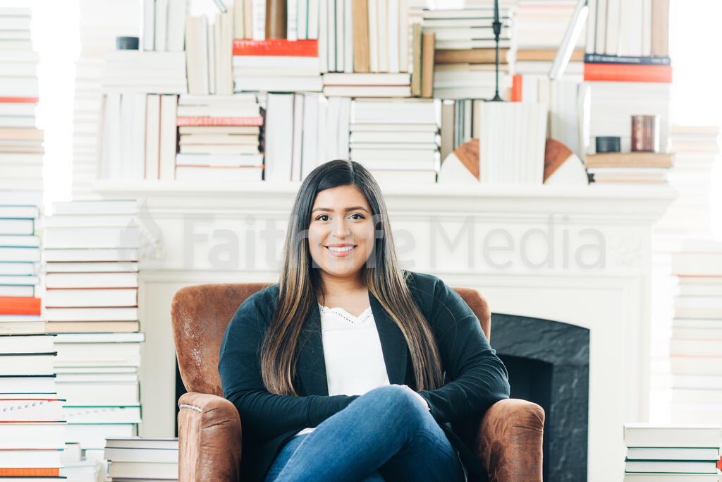 A Woman Sitting Surrounded by Books large preview