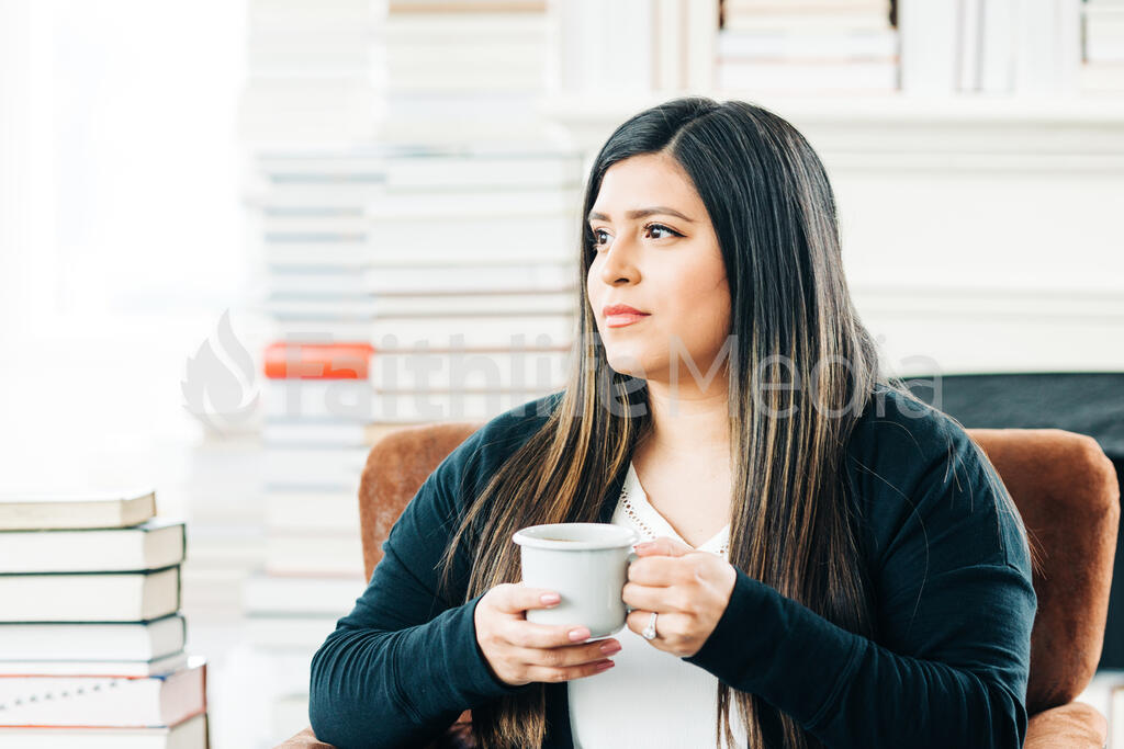 Woman Drinking Coffee Surrounded by Books large preview