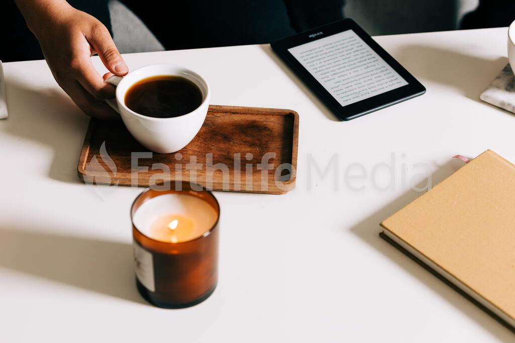 Woman Grabbing a Mug From the Coffee Table large preview