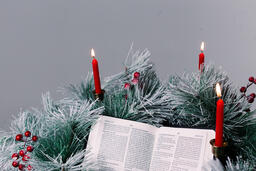 Bible Open to the Christmas Story with Greenery and Candles  image 3