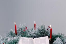 Bible Open to the Christmas Story with Greenery and Candles  image 5