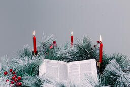 Bible Open to the Christmas Story with Greenery and Candles  image 4