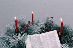 Bible Open to the Christmas Story with Greenery and Candles  image 2