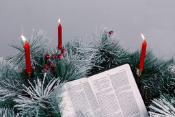 Bible Open to the Christmas Story with Greenery and Candles  image 7