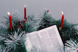 Bible Open to the Christmas Story with Greenery and Candles  image 6