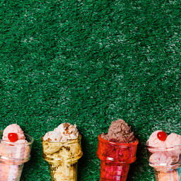 Ice Cream in Colorful Cone Dishes on Grass  image 1