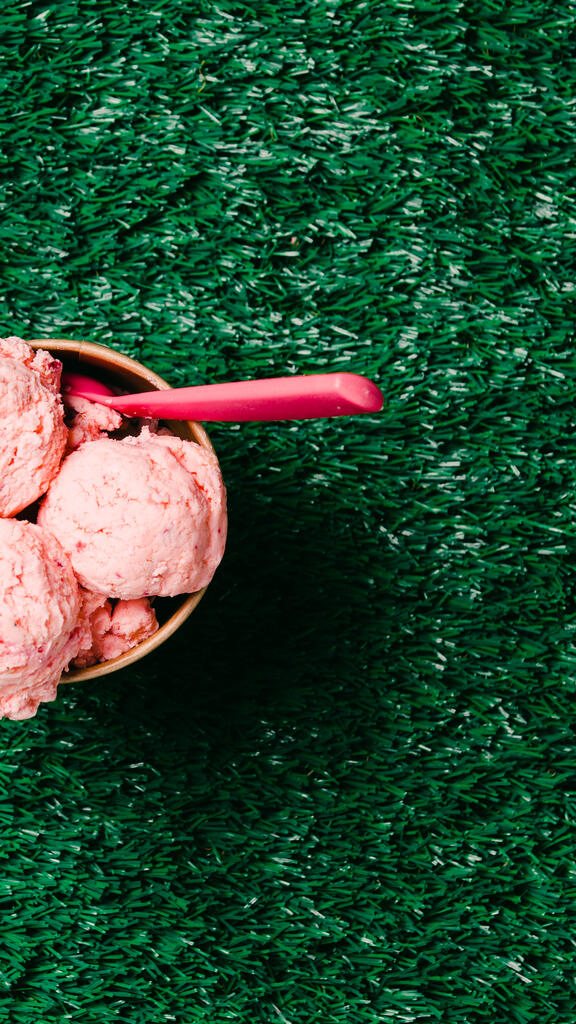 Carton of Strawberry Ice Cream with a Spoon on Grass large preview