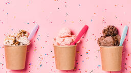 Cartons of Ice Cream with Spoons on Pink Background  image 6