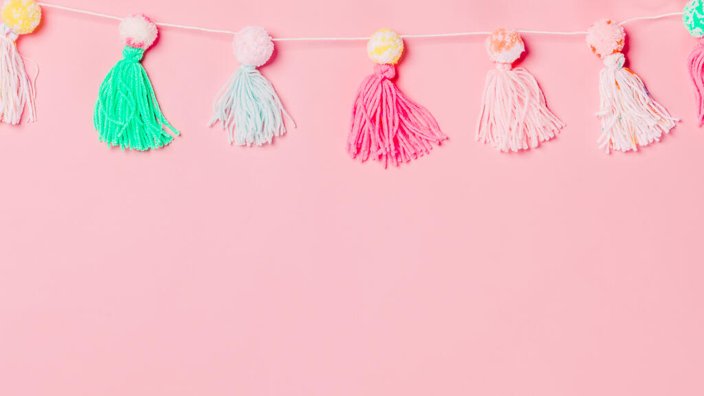 Yarn Tassel Garland on Pink Background large preview