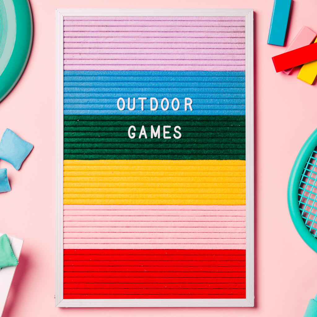Outdoor Games Letter Board with Game Supplies on Pink Background large preview