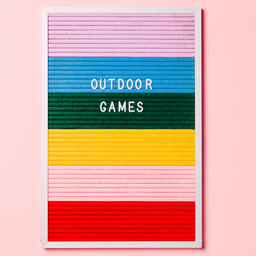 Outdoor Games Letter Board with Game Supplies on Pink Background  image 1