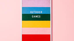 Outdoor Games Letter Board with Game Supplies on Pink Background  image 5