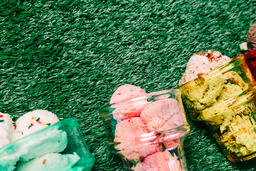Ice Cream in Colorful Cone Dishes on Grass  image 5