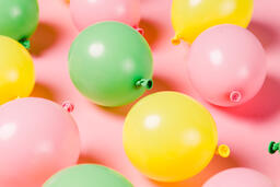 Citrus Colored Balloons Scattered on Pink Background  image 19