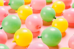 Citrus Colored Balloons Scattered on Pink Background  image 10