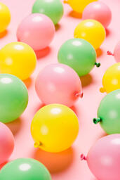 Citrus Colored Balloons Scattered on Pink Background  image 12