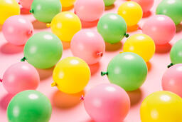 Citrus Colored Balloons Scattered on Pink Background  image 11