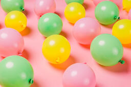 Citrus Colored Balloons Scattered on Pink Background  image 9
