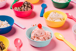 Bowls of Ice Cream and Spoons on Pink Background  image 20