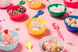 Bowls of Ice Cream and Spoons on Pink Background  image 10