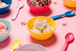 Bowls of Ice Cream and Spoons on Pink Background  image 2